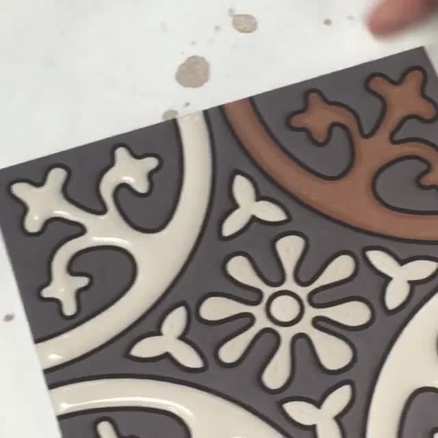 Filling in the last bit of glaze on a tile