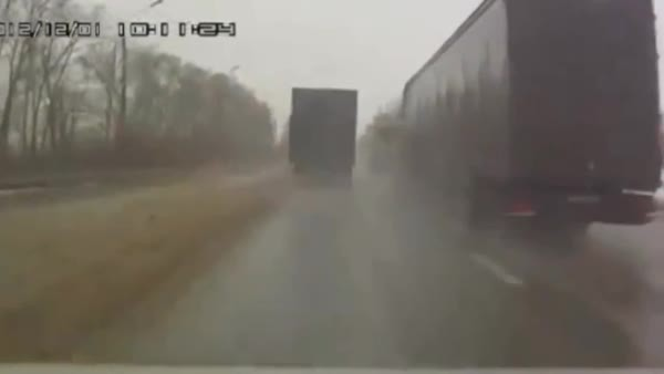Truck pushes car into oncoming trucks.