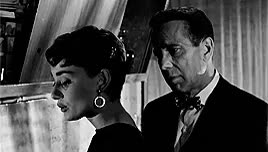 Watch and share Humphery Bogart GIFs and Audrey Hepburn GIFs on Gfycat