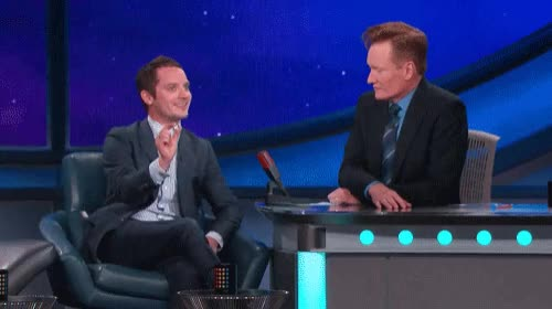 Watch and share Elijah Wood GIFs and Conan GIFs on Gfycat