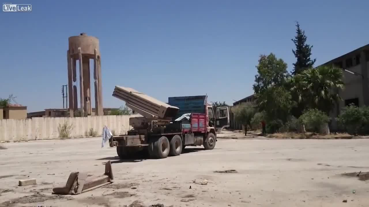 militarygfys, Syrian rebels firing some Grads off the back of a truck (reddit) GIFs