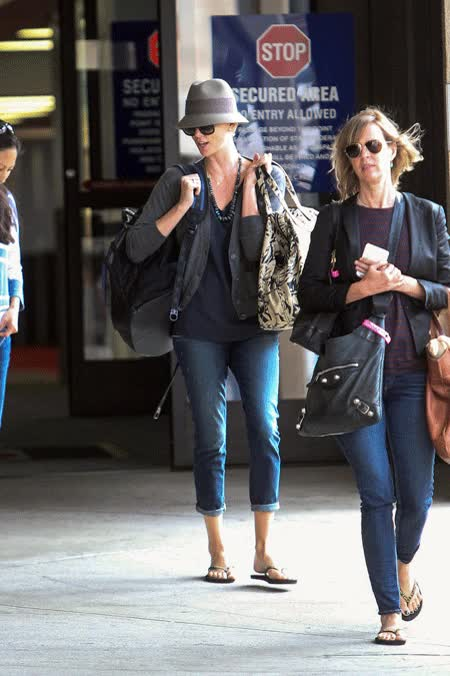 Watch and share Charlize Theron Snacks On Some Starbucks After Arriving At LAX! GIFs on Gfycat