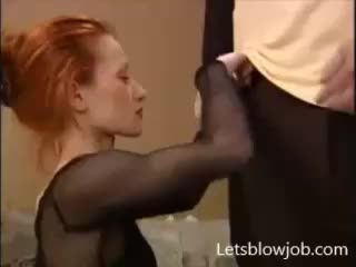 sexy redhead engulfing pecker