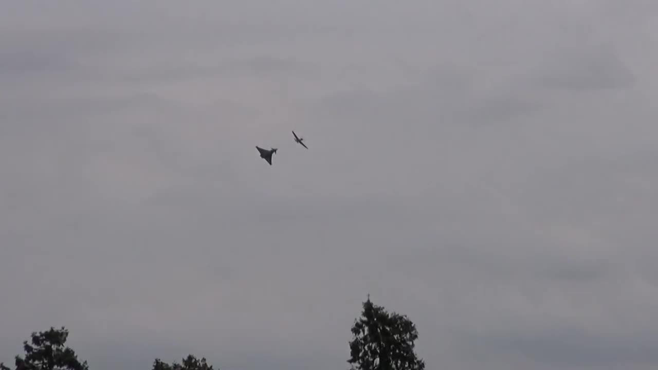 militarygfys, Typhoon in camo paint flying with a Spitty. (reddit) GIFs
