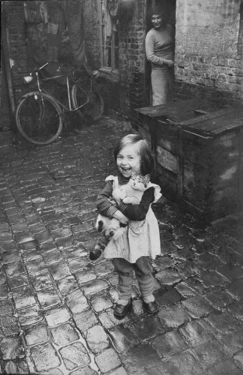 Happy French girl and her cat (1959). : OldSchoolCool GIFs