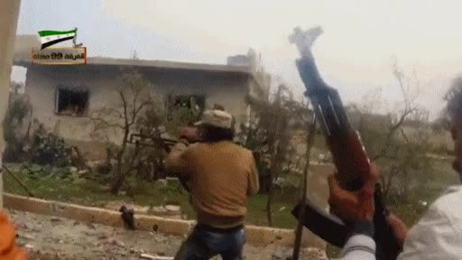 A Syrian rebel with machine gun drop dead and lost his hat forever