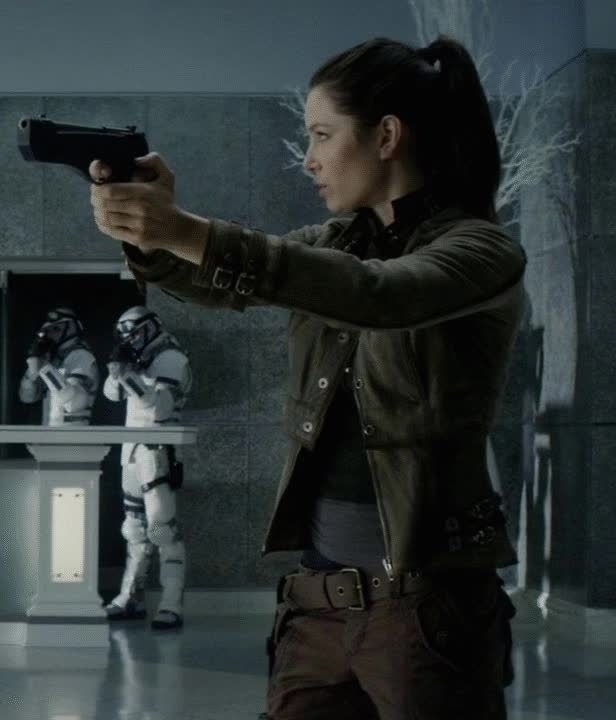 Watch and share Melina Jessica Biel Total Recall Jacket GIFs on Gfycat