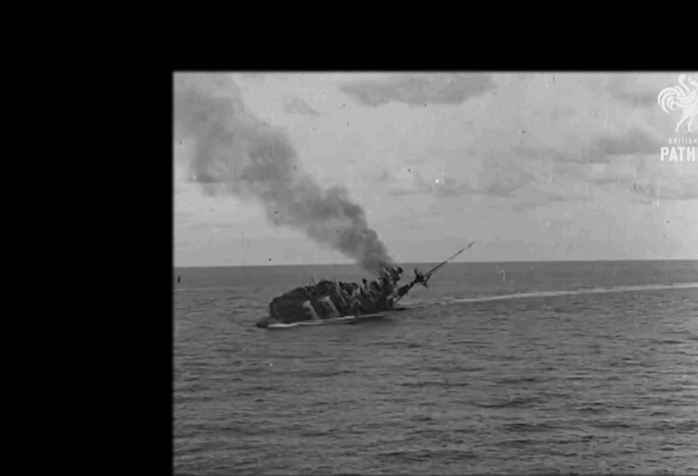 MilitaryGfys, gifs, warshipporn, 25 November 1941: Newsreel footage captures sailors scrambling on the hull of the HMS Barham as she capsizes and her magazines explode. [WWII] [OC stabilized] [source in comments] (reddit) GIFs