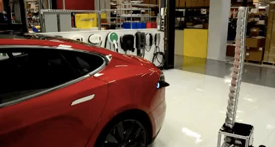 Watch and share Tesla Made Electronic Danger Noodles That Find And Charge Their Cars Automagically GIFs on Gfycat
