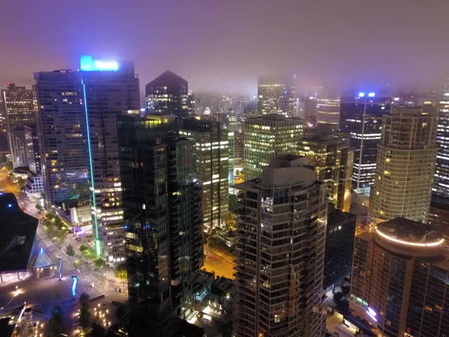 Watch and share Vancouver Downtown Foggy Timelapse GIFs on Gfycat