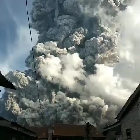 Watch and share Mount Sinabung Erupting Yesterday And Sending A Column Of Ash 5 Miles Into The Air GIFs by tothetenthpower on Gfycat