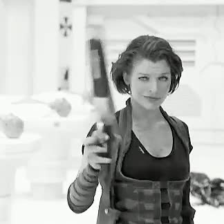 Watch and share Milla Jovovich GIFs and Gun GIFs on Gfycat