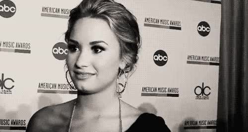 Watch and share Demi Lovato Smile GIFs on Gfycat