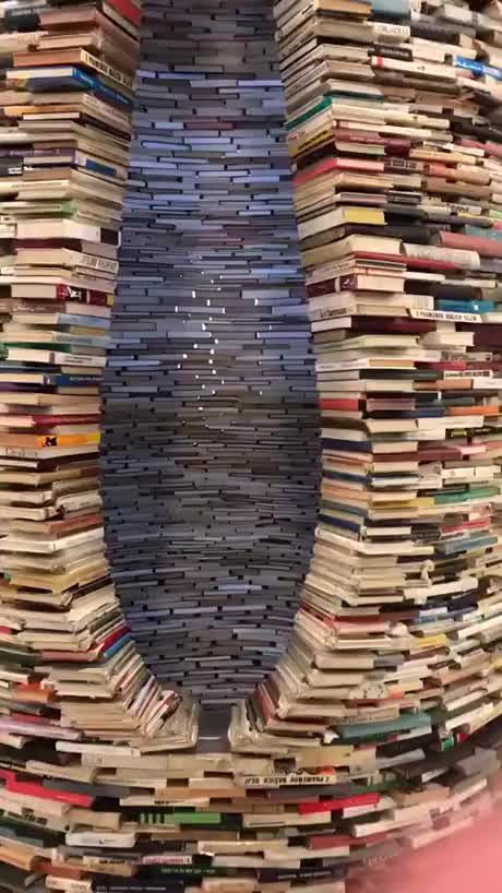 Infinite Book Tunnel Illusion in Prague Library - gif