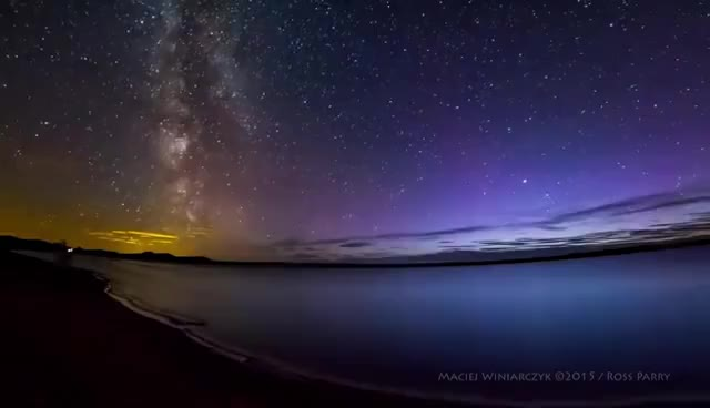 Watch and share Stunning Milky Way Time-lapse Photobombed By Aurora Borealis GIFs on Gfycat