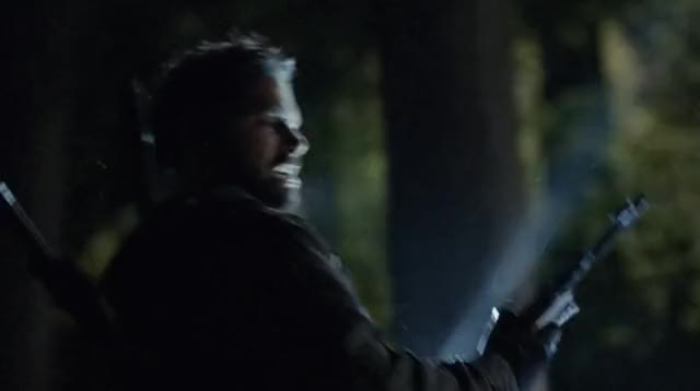 Slade Wilson Snaps a Rifle
