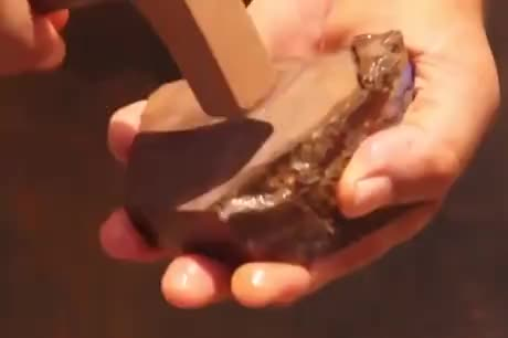 Splitting Open A Boulder Opal To See Its Beauty - gif