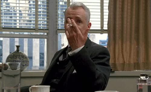 Watch and share Roger SterlinG GIFs on Gfycat