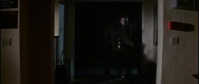 Halloween 2 Michael Myers Walks Through A Door And Gets Shot Gif