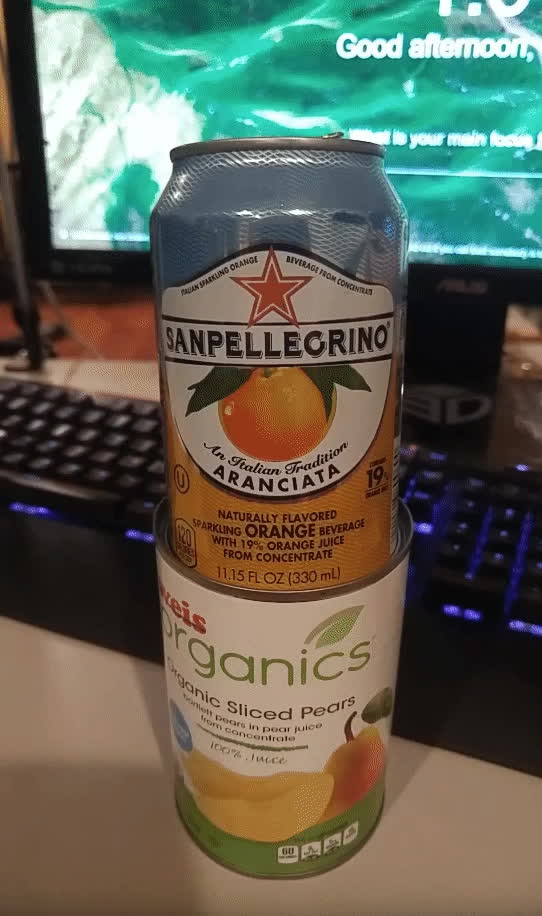 Perfectfit, oddlysatisfying, popular, Sanpellegrino can glides into empty pear can perfectly GIFs