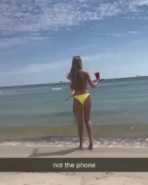 The worst attempt to throw a phone to shore I've ever seen GIFs