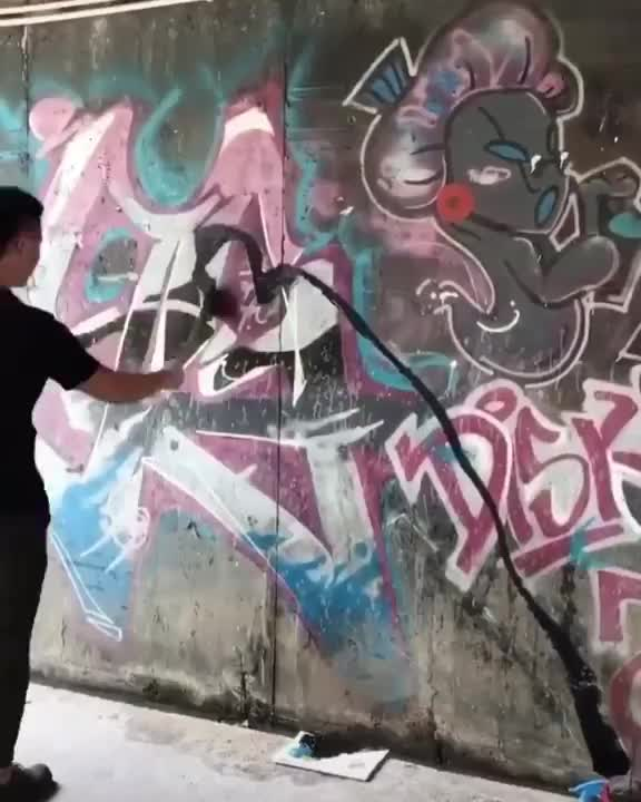 Graffiti artist creating an incredible three dimensional mural GIFs