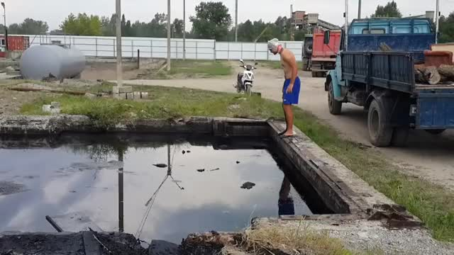 Watch and share Crazy Man  Dives Into The Oil In Russia GIFs on Gfycat