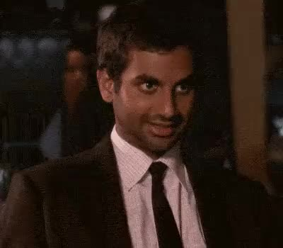 Watch and share Aziz Ansari GIFs and Smile GIFs by Yuyu on Gfycat