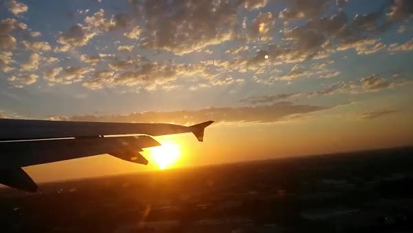 Watch and share Amazing Sunset Flying Out Of Orange County GIFs by eriksummer on Gfycat