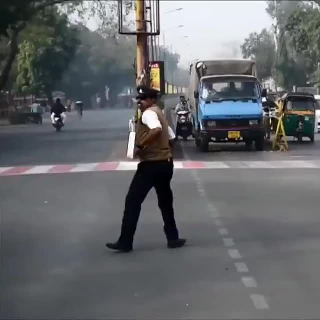 Watch and share [r/IndiaNonPolitical] India's MoonWalking Traffic Cop GIFs by rupliftingkhabre on Gfycat