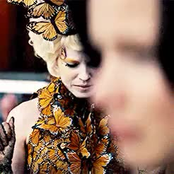 Watch and share Catching Fire GIFs and Effie Trinket GIFs on Gfycat