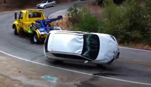Watch and share Tow Truck Trying To Flip Car GIFs on Gfycat
