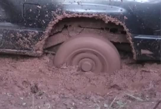 Watch and share Wheel Stuck Mud Deep GIFs on Gfycat