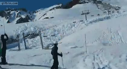 skiers witness an avalanche