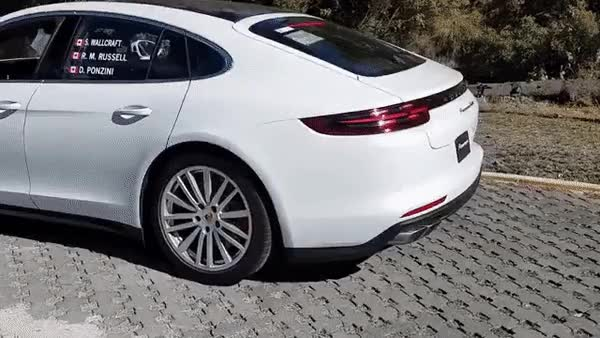 Watch and share The Porsche Panamera's Spoiler GIFs on Gfycat