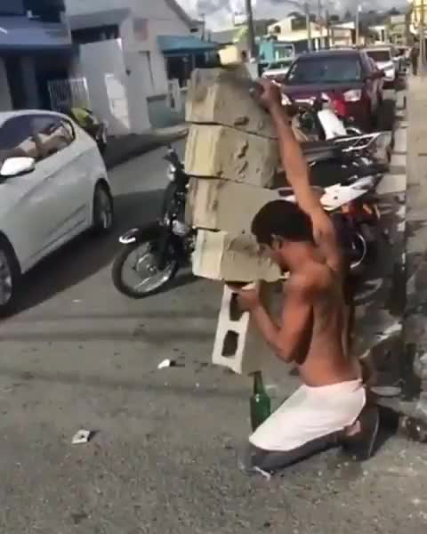 Balancing cinderblocks on a beer bottle GIFs
