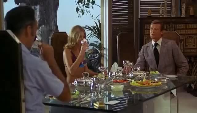 The Man With The Golden Gun Dinner Party Gif Find Make Share