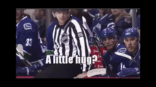Watch and share Hockey Ref Hug GIFs by foodenator on Gfycat