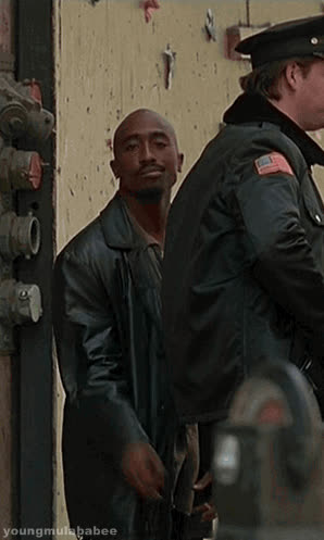2pac, fuck, middle finger, middlefinger, police, tupac, tupac shakur,