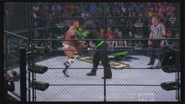 Eric Young Overselling a shoulder into a propped Steel chair