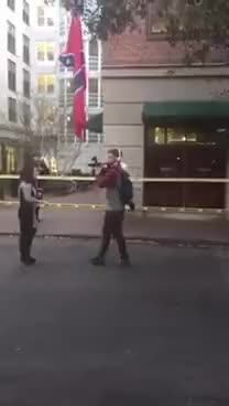 Watch Muhiyidin d'Baha grabs Confederate flag at protest. GIF on Gfycat. Discover more related GIFs on Gfycat