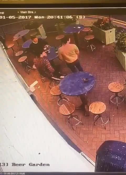 Restaurant patron casually catches a rock that a vandal threw at one of the restaurant's windows GIFs