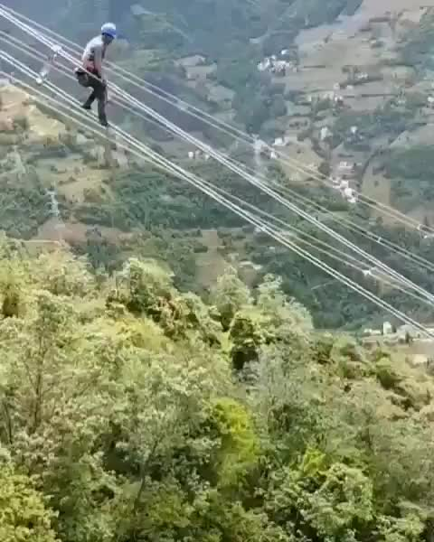 Watch and share Lineman Riding Down A Powerline GIFs by tothetenthpower on Gfycat