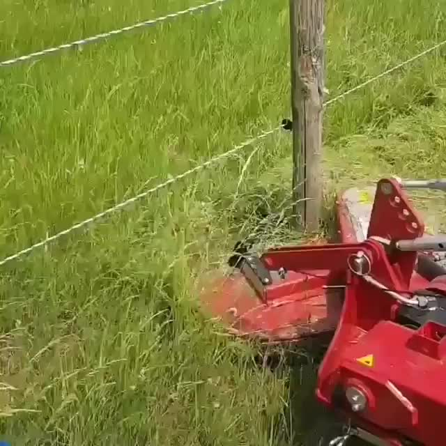 Mower designed to cut around fence posts GIFs
