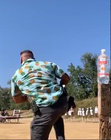 Watch and share Bottle Cap Challenge GIFs and Gun GIFs on Gfycat