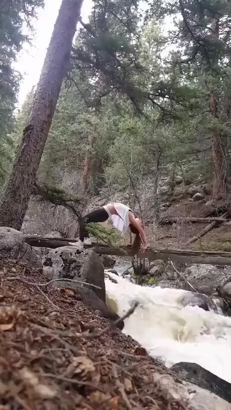 Doing yoga on log gif