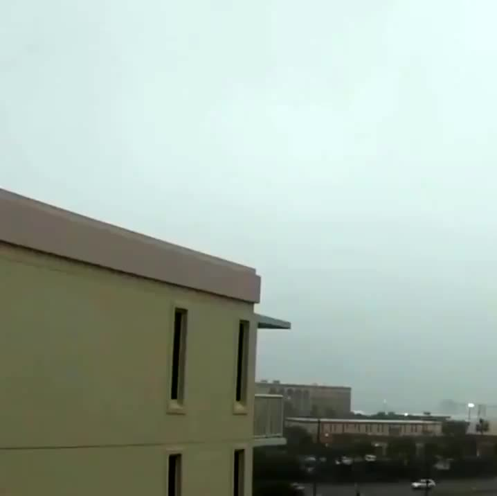 Lightning strike hitting the corner of a building GIFs