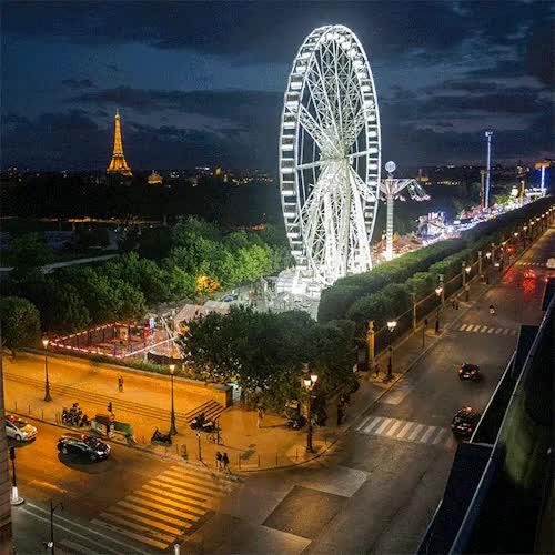 Watch and share Rueda De La Fortuna GIFs and La Tour Eiffel GIFs on Gfycat