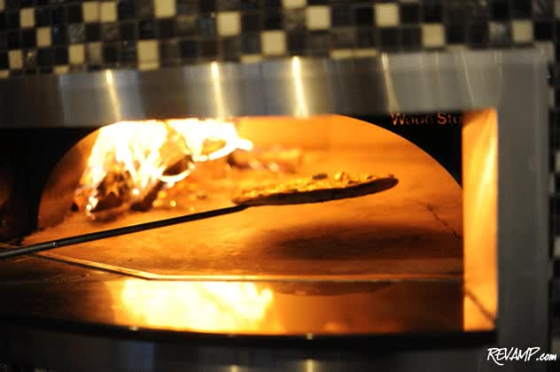Watch and share The Wood-burning Pizza Oven Is Constantly In Use. GIFs on Gfycat