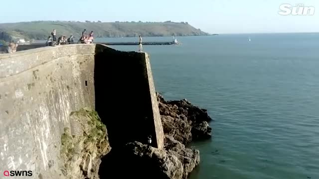 Watch and share Teen Daredevils Filmed Risking Their Lives 'tombstoning' 65ft At Notorious Danger Spot GIFs on Gfycat